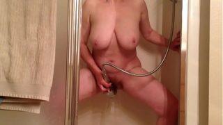 Marie loves shower head orgasms